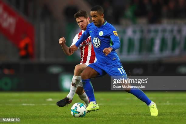 Salih Ozcan of FC Koeln tackles Daniel Didavi of Wolfsburg during the Bundesliga match between 1 FC Koeln and VfL Wolfsburg at RheinEnergieStadion on...