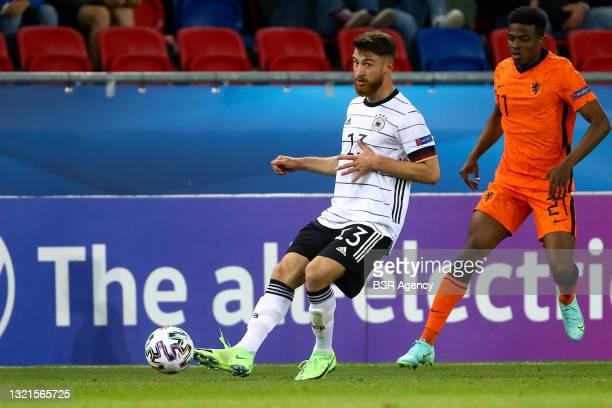 Salih Ozcan of Germany U21 and Javairo Dilrosun of the Netherlands U21 during the 2021 UEFA European Under-21 Championship Semi-Finals match between...
