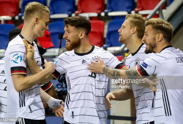 Salih Ozcan of Germany U21 celebrates his side's first goal with his team mates during the 2021 UEFA European Under-21 Championship Semi-Finals match...