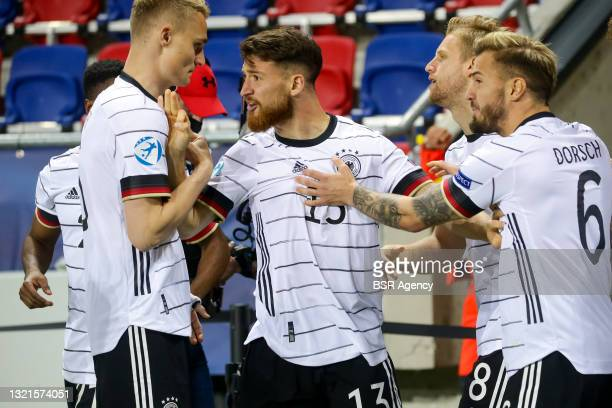 Salih Ozcan of Germany U21 celebrates his sides first goal with his team mates during the 2021 UEFA European Under-21 Championship Semi-Finals match...