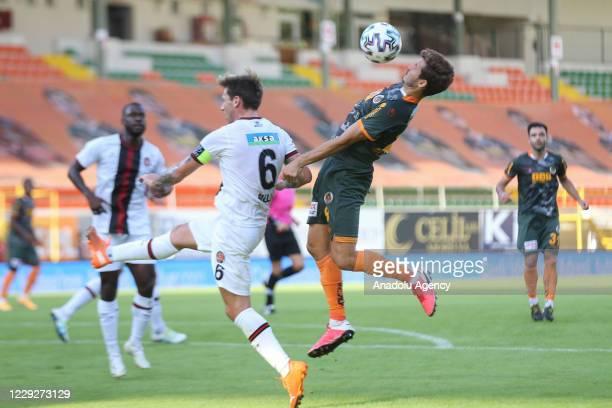 Salih Ucan of Aytemiz Alanyaspor in action against Lucas Biglia of Fatih Karagumruk during Turkish Super Lig week 6 soccer match between Aytemiz...