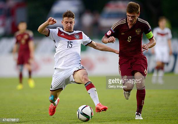 Salih zcan of Germany U17 challenges Georgi Makhatadze of Russia U17 during the UEFA European Under17 Championship Semi Final match between Germany...