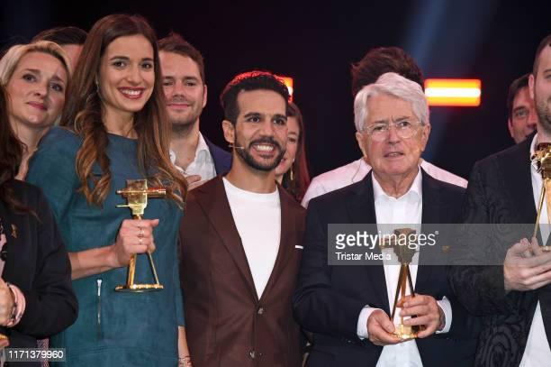 Saliha Oezcan Daniele Rizzo and Frank Elstner attend the YouTube Goldene Kamera Digital Awards at Kraftwerk on September 26 2019 in Berlin Germany