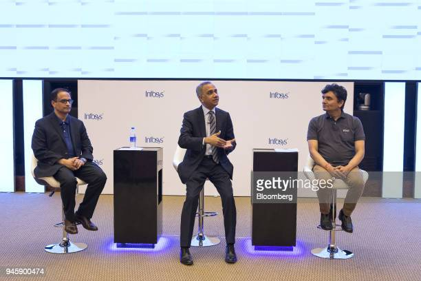 Salil Parekh chief executive officer of Infosys Ltd center speaks as Pravin Rao chief operating officer of Infosys Ltd left and Ranganath D...