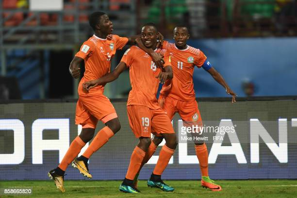 Salim Abdourahmane of Niger celebrates with team mates Farouk Idrissa and Karim Tinni after scoring the first goal of the game during the FIFA U17...