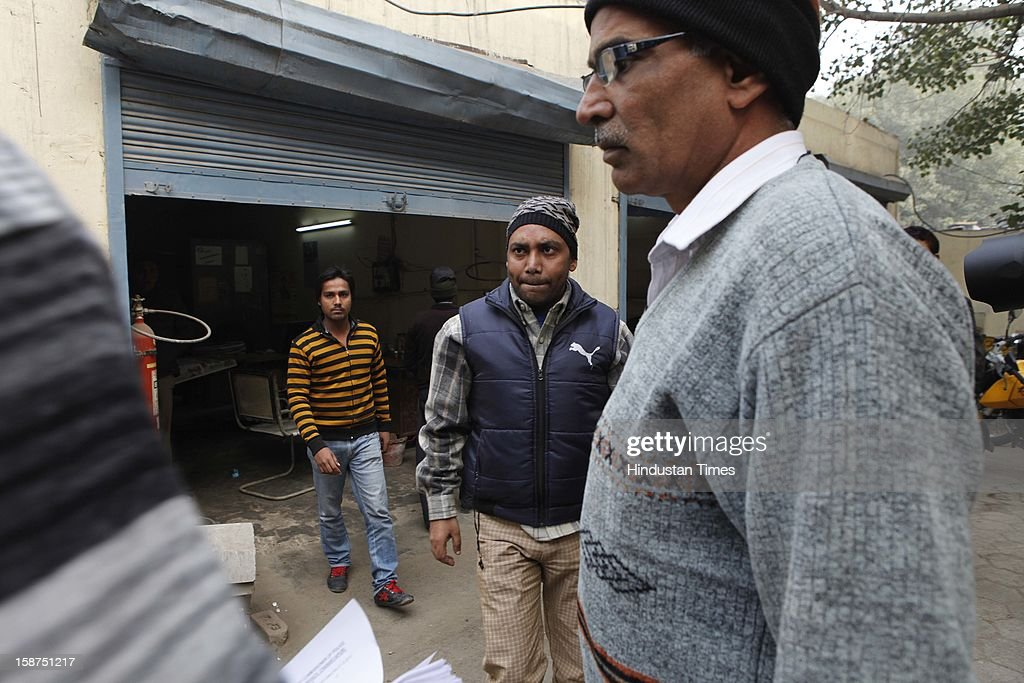 Salim Alvi (C) The eyewitness to the incident of the death of Police Constable Subhash Chand Tomer being taken to Crime Branch Chanakya Puri at Parliament Street Police Station on December 27, 2012 in New Delhi, India. Delhi police constable Subash Chand died during the India Gate protest march against the recent Gang Rape case on December 24, 2012.