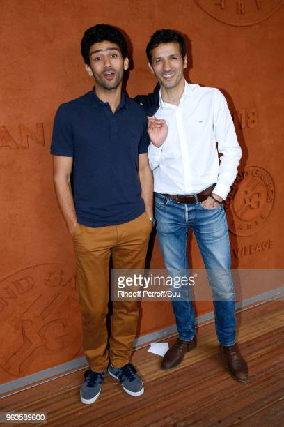 Salim Kechiouche and Kamel Belghazi attend the 2018 French Open Day Three at Roland Garros on May 29 2018 in Paris France