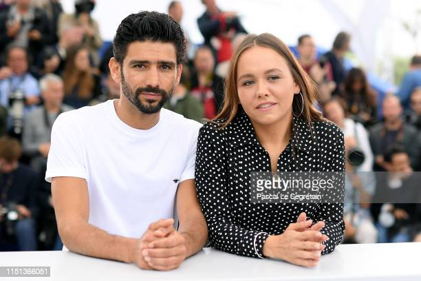 Salim Kechiouche and Lou Luttiau attend the photocall for Mektoub My Love Intermezzo during the 72nd annual Cannes Film Festival on May 24 2019 in...