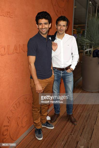 Salim Kechiouche andKamel Belghazi attend the 2018 French Open Day Three at Roland Garros on May 29 2018 in Paris France