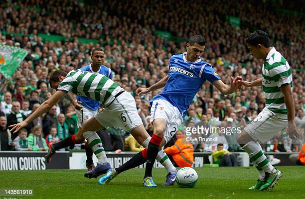 Salim Kerkar of Rangers moves away from Joe Ledley of Celtic during the Clydesdale Bank Premier League match between Celtic and Rangers at Celtic...