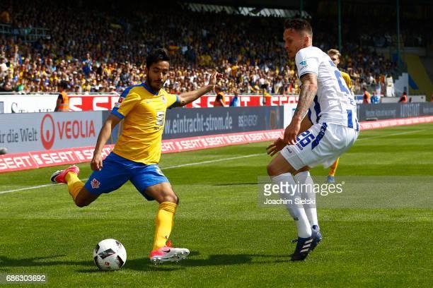 Salim Khelifi of Braunschweig challenges Bjarne Thoelke of Karlsruhe during the Second Bundesliga match between Eintracht Braunschweig and Karlsruher...