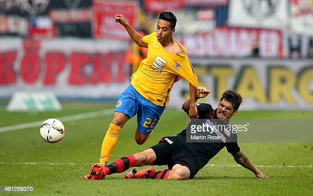 Salim Khelifi of Braunschweig challenges for the ball with Dennis Daube of Union Berlin during the Second Bundesliga match between Eintracht...