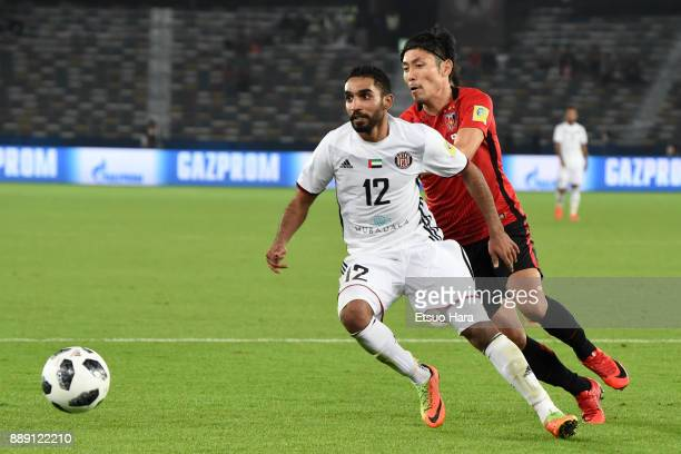 Salim Rashid of Al Jazira and Ryota Moriwaki of Urawa Red Diamonds compete for the ball during the FIFA Club World Cup match between Al Jazira and...