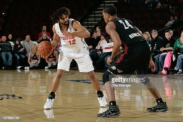 Salim Stoudamire of the Idaho Stampede protects the ball against Brian Hamilton of the Utah Flash during a game on December 11 2010 at Qwest Arena in...