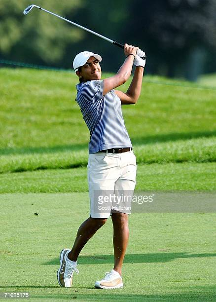 Salimah Mussani of Canada watches her approach shot on the 15th hole during the first round of the CN Canadian Women's Open at the London Hunt and...