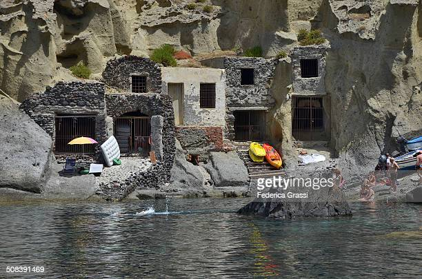 Salina is one of the seven Aeolian islands north of Sicily. These buildings were used by the fishermen to store their small boats and fishing nets,...