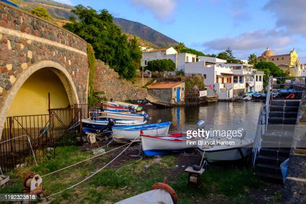 salina, italy - november 11, 2019 - the harbour of the aeolian island of salina - boats safe in the lagoon - finn bjurvoll stock pictures, royalty-free photos & images