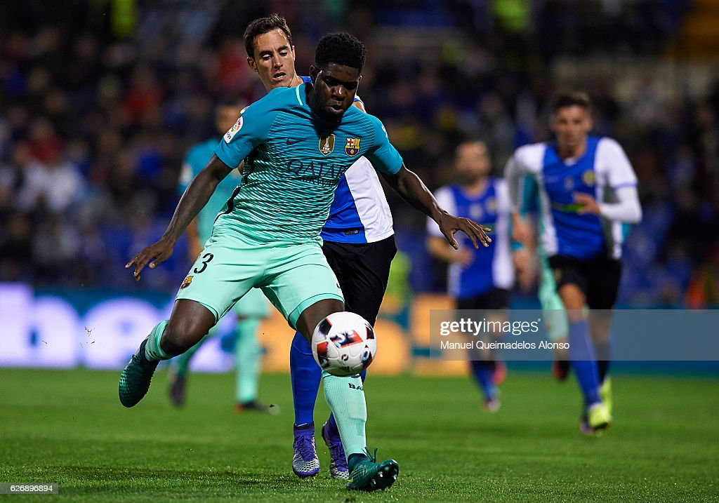 Salinas (L) of Hecules competes for the ball with Samuel Umtiti of Barcelona during the La Copa del Rey first leg match between Hercules CF and FC Barcelona at Jose Rico Perez on November 30, 2016 in Alicante, Spain.