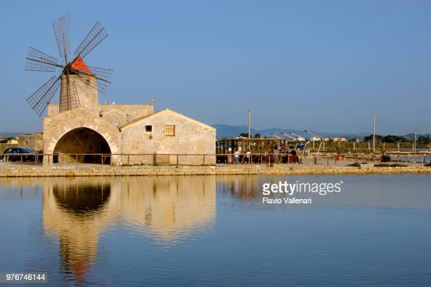 saline della laguna, marsala (sicily, italy) - traditional windmill stock photos and pictures