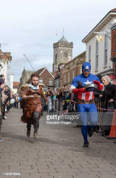 Salisbury 5th Competitors competing in the annual pancake race on High Street Salisbury The event is organized by St Thomass Church and the Trussell...