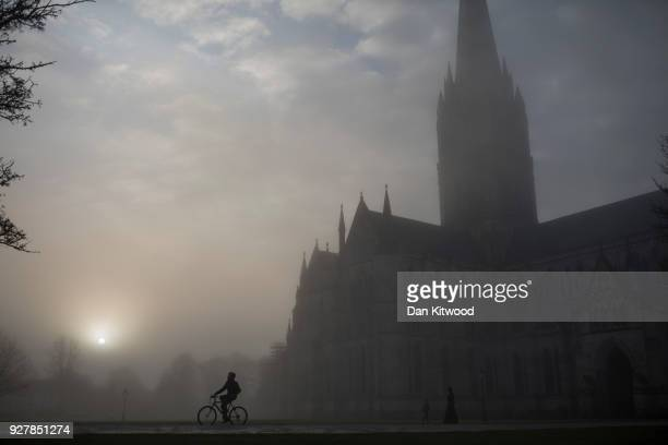 Salisbury Cathedral emerges from a morning fog in town centre where a man and woman had been found unconscious two days previosly on March 6 2018 in...