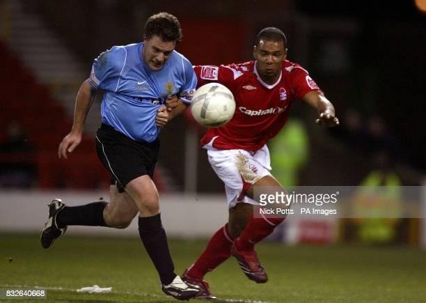 Salisbury City's Matthew Holmes and Nottingham Forest's Julian Bennett