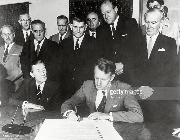 Rhodesia Declares Independence Ian Smith Rhodesian Premier signs declaration of independence as Rhodesian officials watch 11/11/65