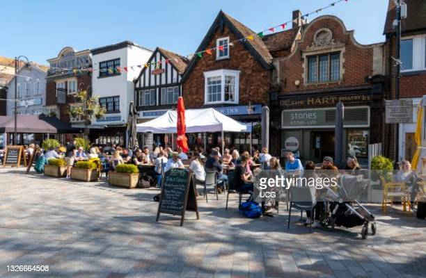 Salisbury, Wiltshire, England, UK, Pubs and restaurants with customers on Market Square as Covid restriction are eased for outside dining.