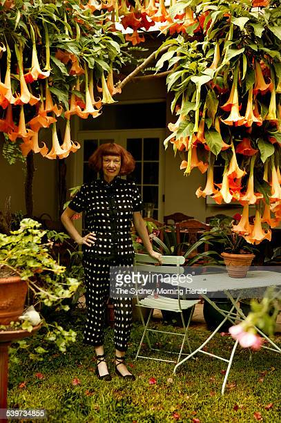 Sally Campbell in the garden of her Randwick home under a Datura tree 2 February 2006 SMH Picture by MARCO DEL GRANDE