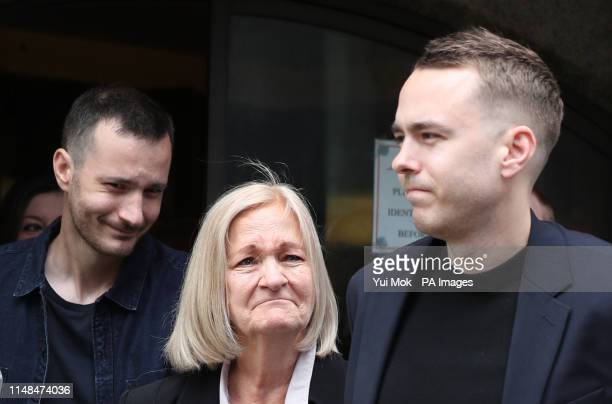 Sally Challen, flanked by her sons James and David , leaves the Old Bailey after hearing she will not face a retrial over the death of her husband...