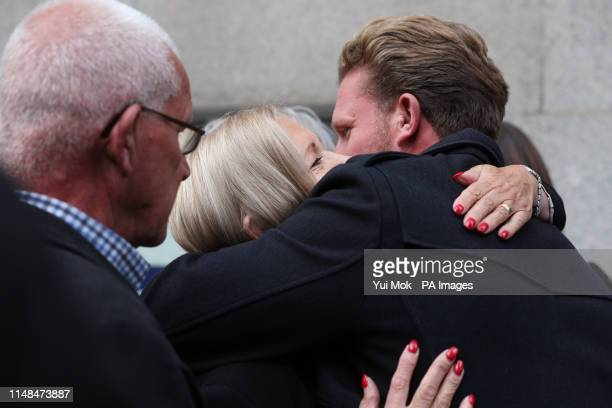 Sally Challen is hugged as she leaves the Old Bailey after hearing she will not face a retrial over the death of her husband Richard Challen in 2010.