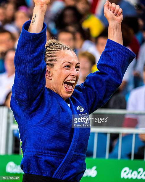 Sally Conway of Great Britain leaves the mat in ecstatic mood exposing her only tatoo saying 'Believe' after defeating Bernadette Graf of Austria by...