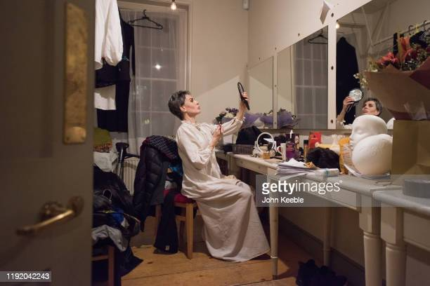 Sally Dexter who plays Scrooge in her dressing room backstage after a performance photocall for 'Christmas Carol - A Fairy Tale' by Piers Torday...