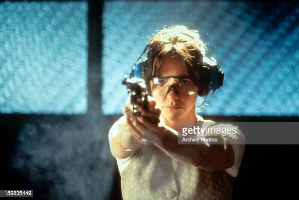 Sally Field at target practice in a scene from the film 'Eye For An Eye', 1996.