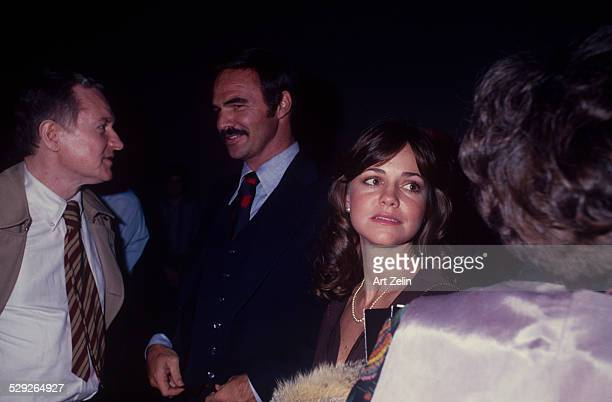 Sally Field with Burt Reynolds talking with friends circa 1970 New York