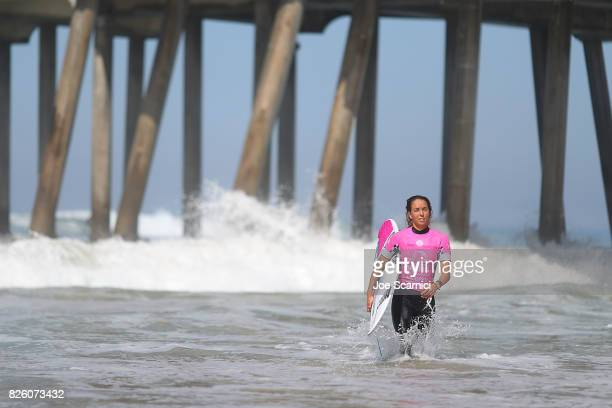 Sally Fitzgibbons exits the water after losing her quarterfinal heat at the Vans US Open of Surfing on August 3 2017 in Huntington Beach California