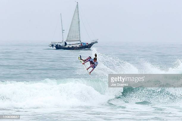 Sally Fitzgibbons of Australia surfing in the quarter finals against Coco Ho of Hawaii at the Nike US Open of Surfing on August 7 2011 in Huntington...