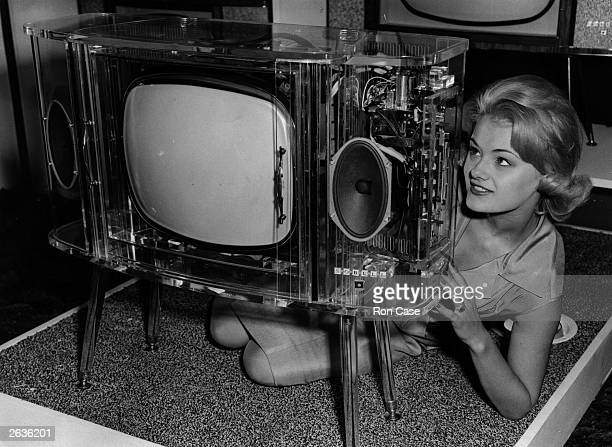 Sally Foot with a slimstyle consul Sobell television set in transparent perspex at the Radio Show Earls Court London