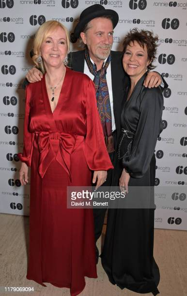 Sally Greene Simon Cooke and Helen McCrory attend A Night At Ronnie Scotts 60th Anniversary Gala at the Royal Albert Hall on October 30 2019 in...