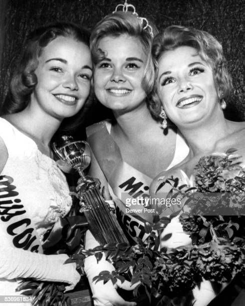 Sally Guinn Miss Colorado Holds Winner's Trophy and Flowers First runnerup in contest was Miss Denver University Judith Rae Caldwell right and second...