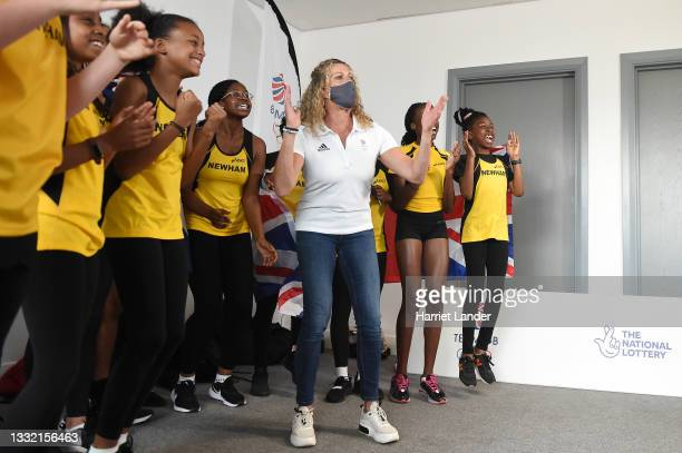 Sally Gunnell, Olympic Gold Medalist, and a group of young athletes cheer on Team Great Britain on the TV during Women's 800m Final as the next...