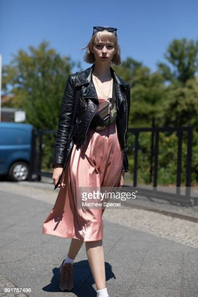 Sally Haas is seen attending Rebekka Ruetz wearing pastel satin dress with black leather jacket during the Berlin Fashion Week July 2018 on July 4...