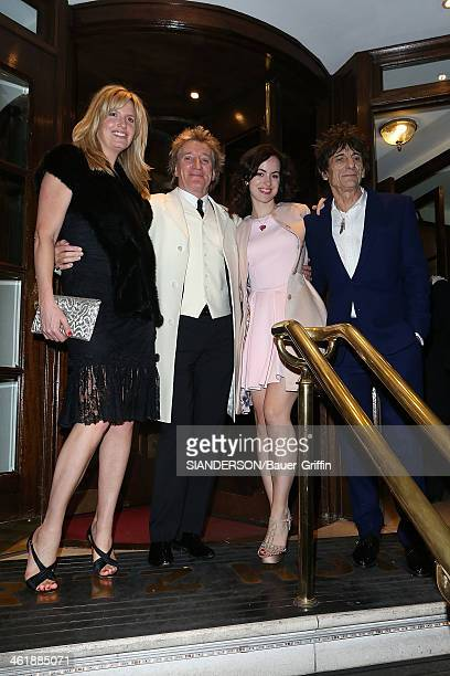 Sally Humphreys and husband Ronnie Wood with Rod Stewart and Penny Lancaster leaving the Ritz hotel in London on December 22 2012 in London United...