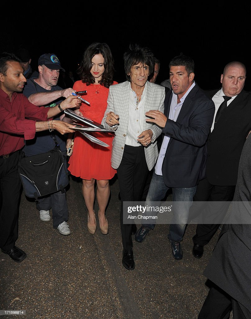 Sally Humphreys and Ronnie Wood sighting leaving the Serpentine Summer Party on June 26, 2013 in London, England.
