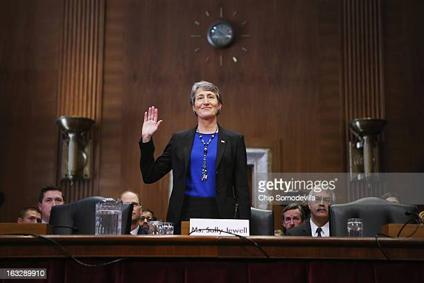 Sally Jewell is sworn in before testifying to the Senate Energy and Natural Resources Committee during her confirmation hearing to be the next...