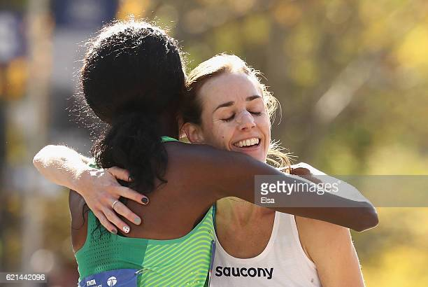 Sally Kipyego of Kenya and Molly Huddle of the United States embrace after the Professional Women's Divsion during the 2016 TCS New York City...