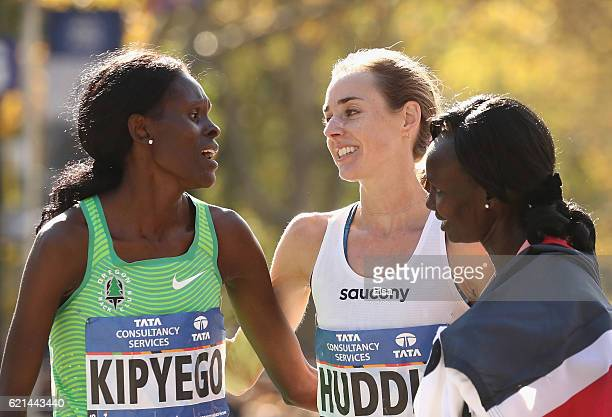 Sally Kipyego of Kenya, Molly Huddle of the United States and Mary Keitany of Kenya embrace after the Professional Women's Divsion during the 2016...
