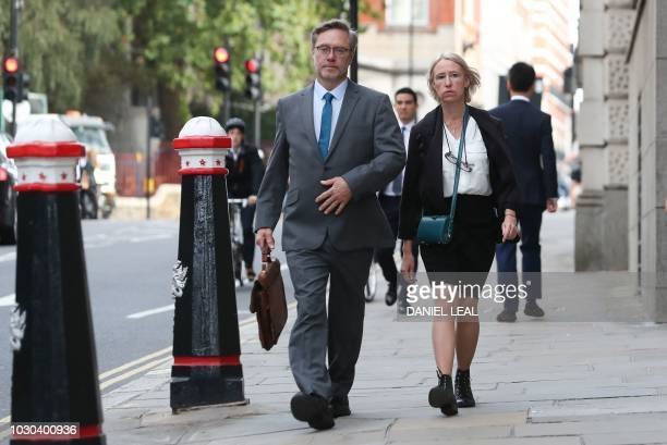 Sally Lane and John Letts parents of Jack Letts who is believed to have left the United Kingdom to join Islamic State arrive at the Old Bailey court...