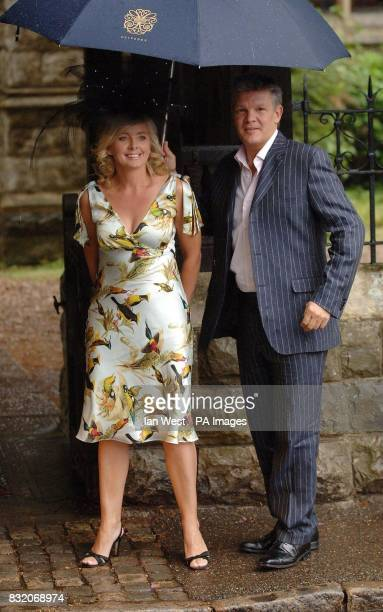 Sally Meen and Russ Lindsay arrive for the wedding of Ant McPartlin to Lisa Armstrong at StNicholas Church in Taplow Buckinghamshire Picture date...