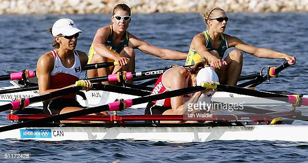 Sally Newmarch and Amber Halliday from Australia row past Mara Jones and Fiona Milne from Canada after competing in the women's lightweight double...